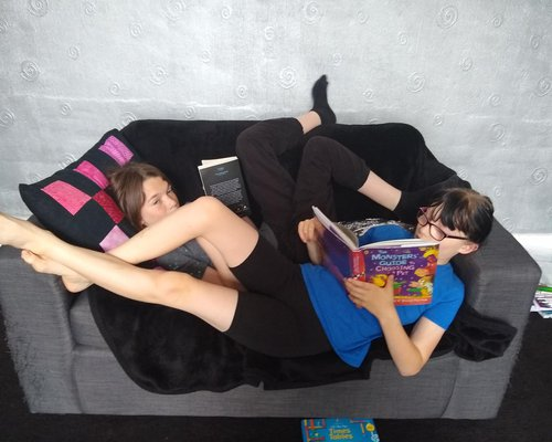 Children on Sofa Reading in Summer Holidays